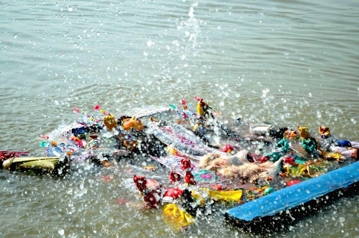:Kolkata: Durga idol immersions underway in Hooghly river on Vijaya Dashmi in Kolkata, on Oct 19, 2018. .