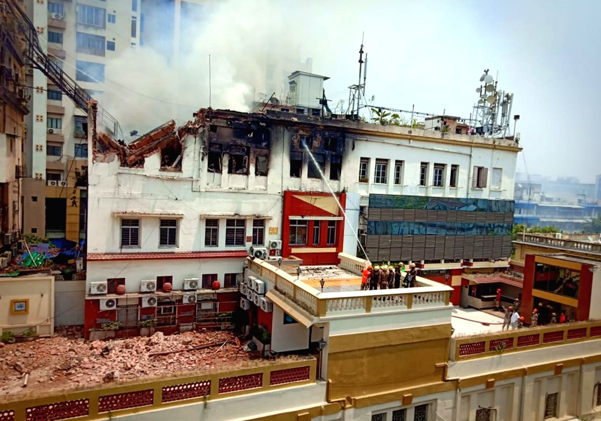 Fire fighters douse a fire that broke out in a four-storeyed building in south Kolkata's bustling Chowringhee Road, in Kolkata