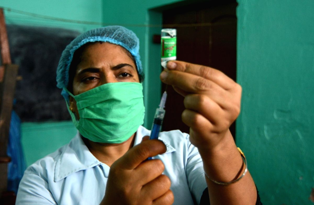Kolkata:  Health workers are giving the vaccine to the local people at Rajarhat Gopalpur area during increasing numbers of COVID 19 cases near  in Kolkata 31 May, 2021. (Photo: Kuntal Chakrabarty/ IANS)