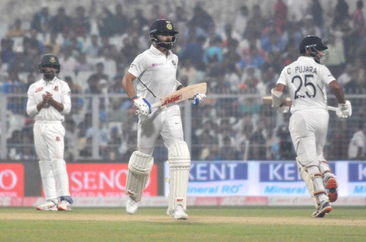 Kolkata: India's Virat Kohli and Cheteshwar Pujara on Day 1 of the 2nd Test match between India and Bangladesh at the Eden Gardens in Kolkata on Nov 22, 2019. This is India and Bangladesh's first pink ball Day-Night Test match. (Photo: Kuntal Chakrab