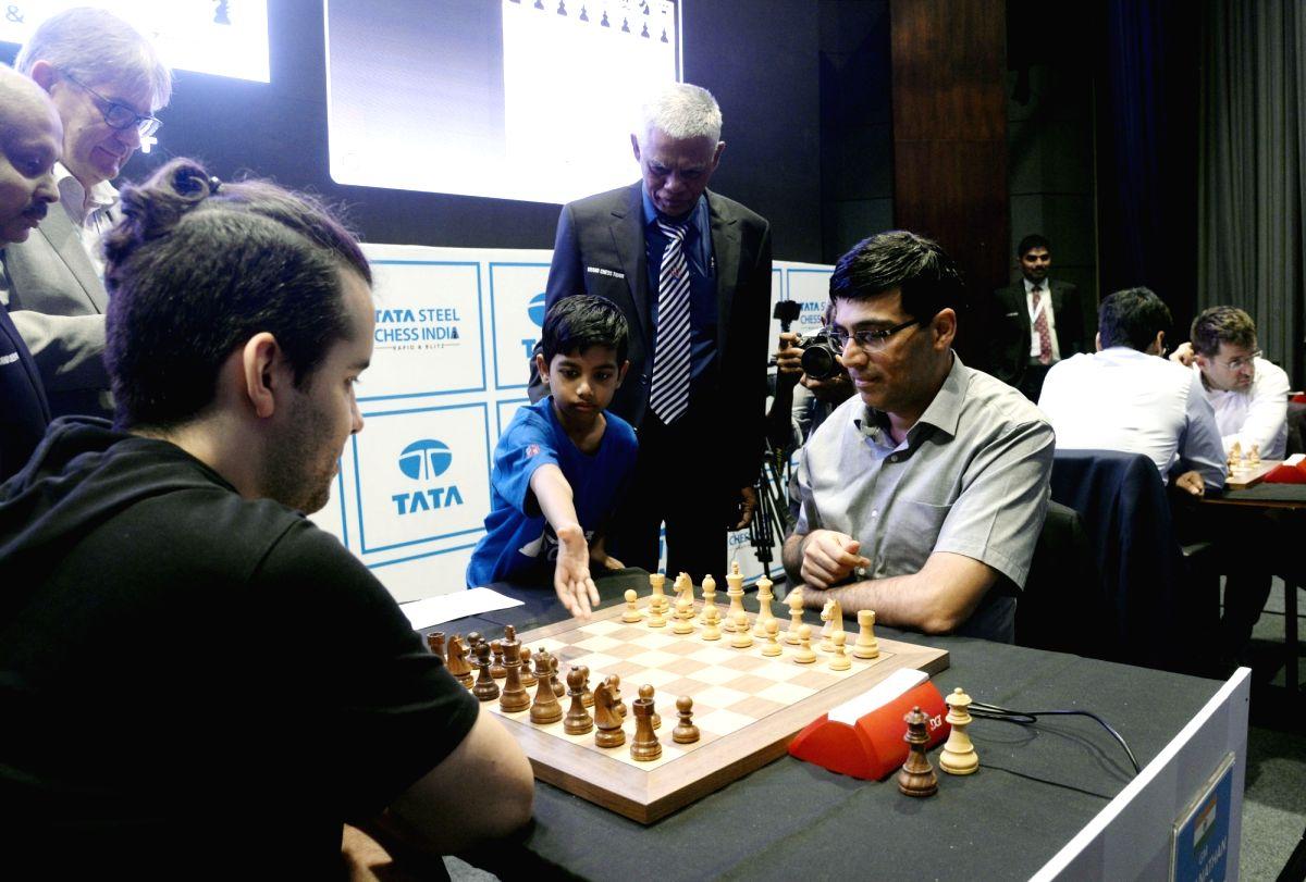 Kolkata: Indian chess Grandmaster Viswanathan Anand and Russian chess grandmaster Ian Nepomniachtchi on the fourth day of Tata Steel Chess India Rapid and Blitz 2019 in Kolkata on Nov 25, 2019.