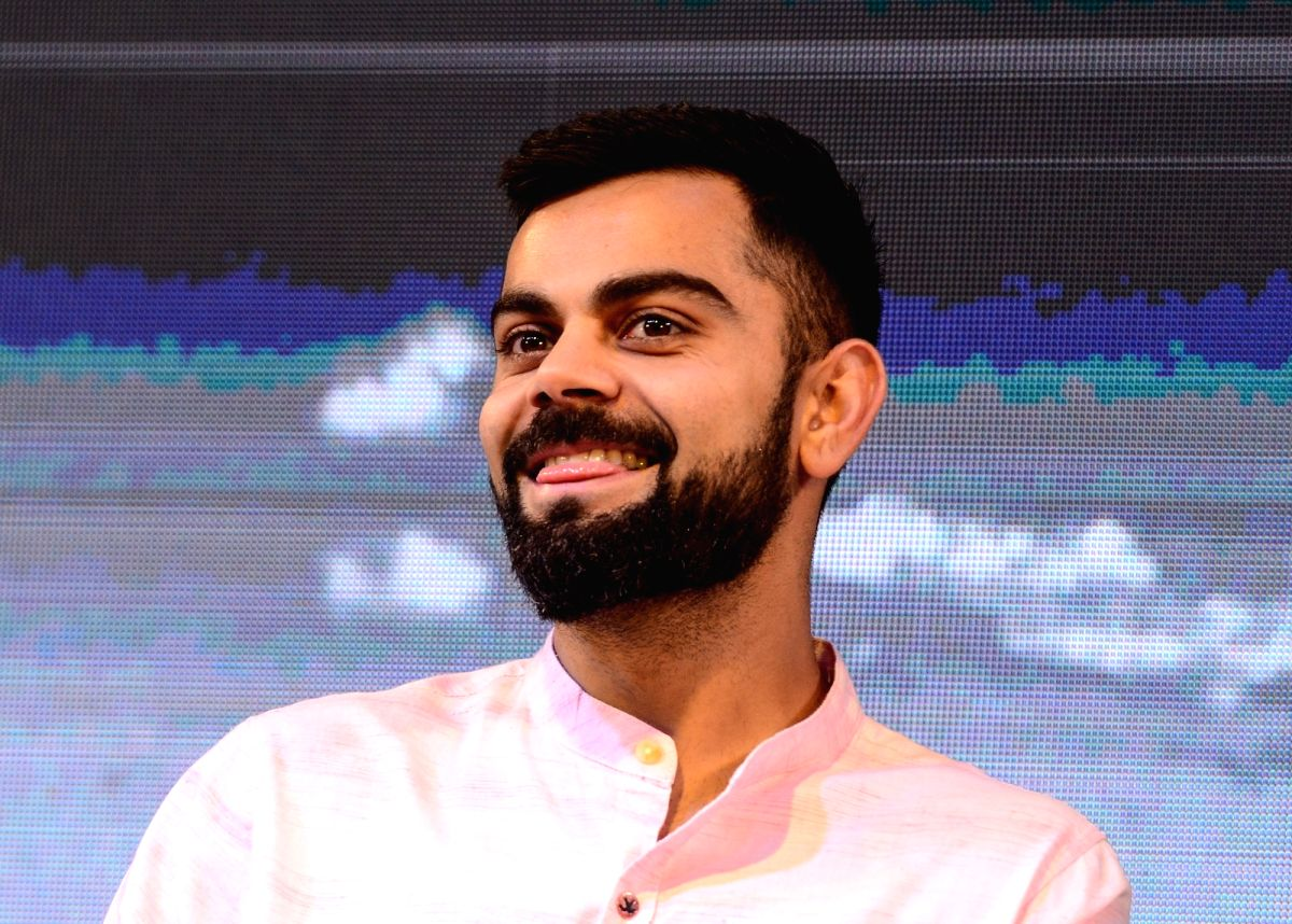: Kolkata: Indian cricket team's captain Virat Kohli during the launch of Boria Majumdar's book 'Eleven Gods and a Billion Indians' in Kolkata on April 7, 2018. (Photo: Kuntal ...