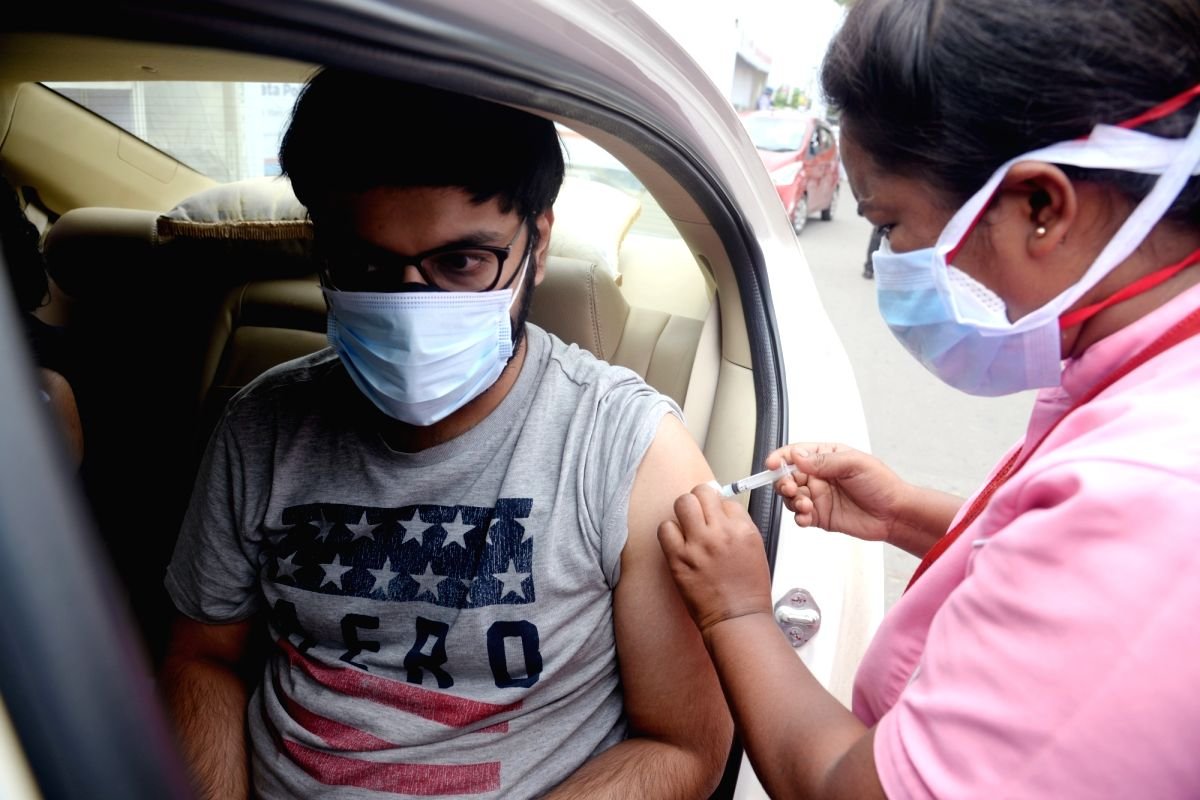 Kolkata:  Medic administers dose of COVID-19 vaccine to a beneficiary during Drive through By Vaccination camp joint initiative by Kolkata Police and AMRI hospital at E.M.Bypass in Kolkata  in Kolkata on Wednesday 09 June, 2021. (Photo: Kuntal Chakra