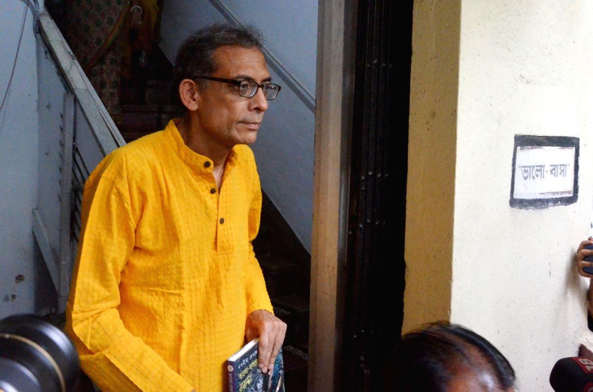 Kolkata: Nobel Laureate economist Abhijit Banerjee comes out after meeting author Nabaneeta Dev Sen, in Kolkata on Oct 23, 2019.