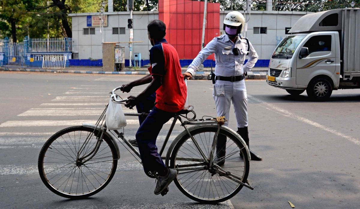 Kolkata: Police personnel intercept violaters during a complete lockdown for 21 days announced by Prime Minister Narendra Modi to prevent further spreading of the COVID 19 pandemic in India; in Kolkata on March 25, 2020. (Photo: Kuntal Chakrabarty/IA