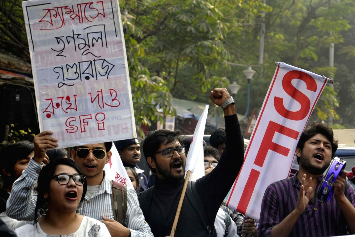 Kolkata: SFI activities take out a protest rally against West Bengal Government at Lalbazar in Kolkata on Dec 23, 2016.