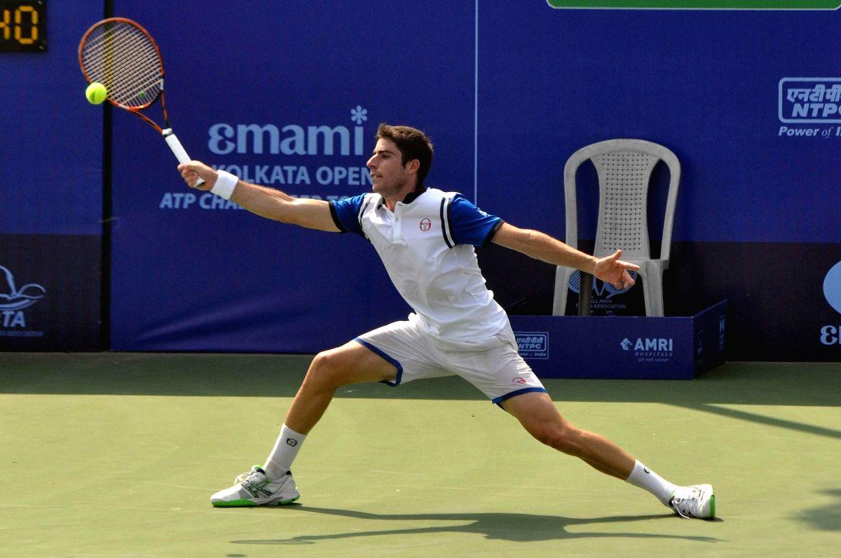 Kolkata: Spanish tennis player Enrique Lopez-Perez in action against Indian tennis player Yuki Bhambri during an Emami Kolkata Open 2015- ATP Challenger match  in Kolkata on Feb 24, 2015. (Photo: Kuntal Chakrabarty/IANS)