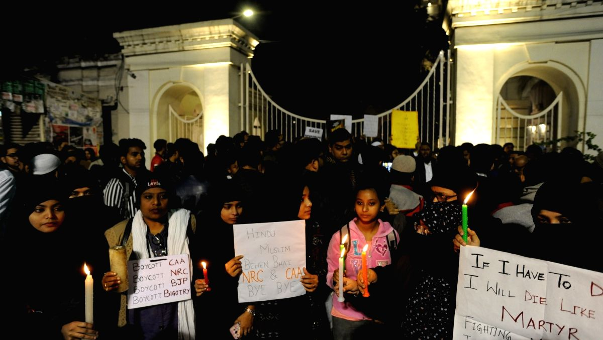 Kolkata: Students participate in a candlelight protest march against the Citizenship Amendment Act (CAA) 2019 and the National Register of Citizens (NRC) from Presidency University to Esplanade, in Kolkata on Dec 28, 2019.