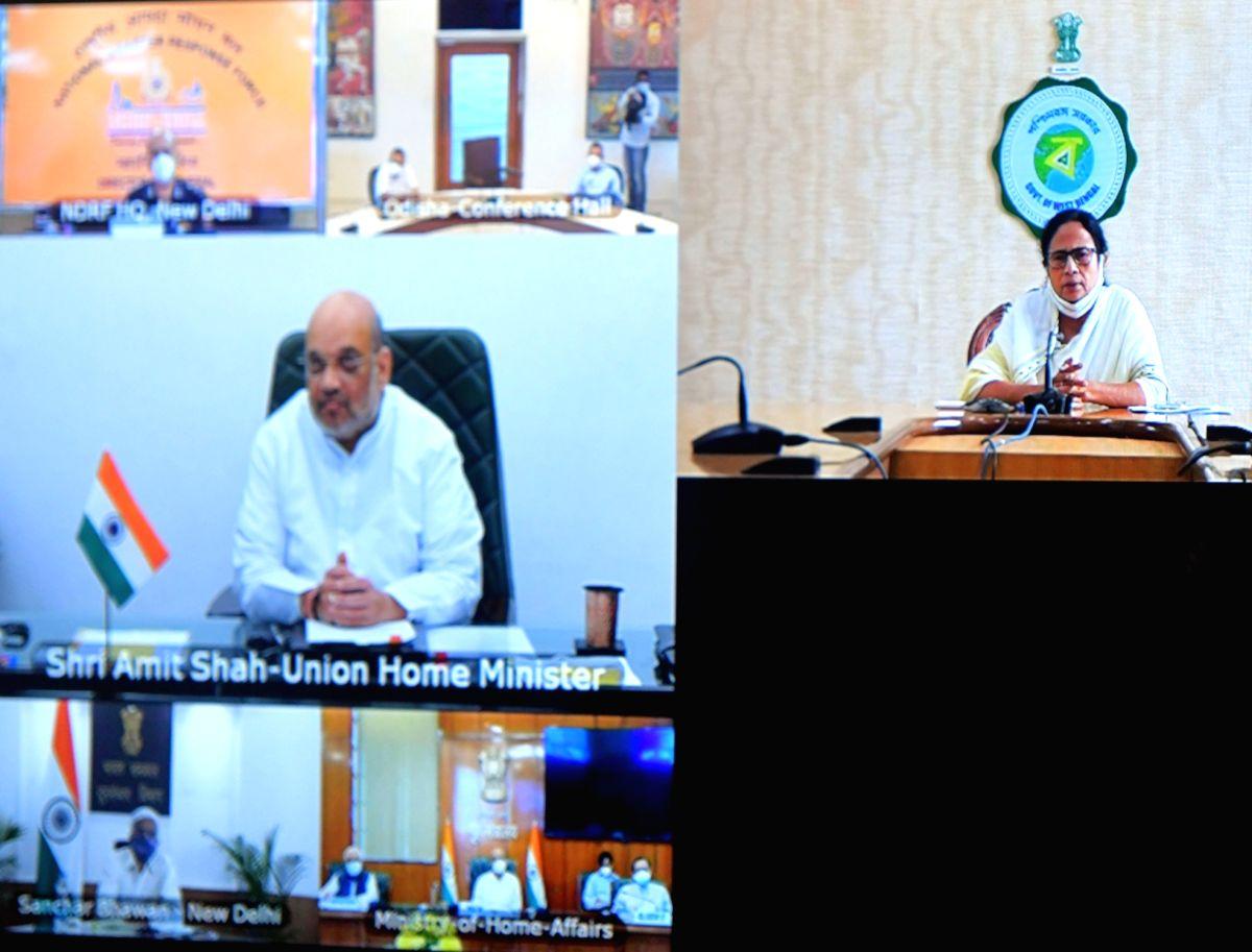 "Kolkata: West Bengal Chief Minister Mamata Banerjee at a video conference with Indian Minister of Home Affairs Amit Shah about super cyclone ""Yash"" at Nabanna at Howrah  in Kolkata   24 May, 2021."