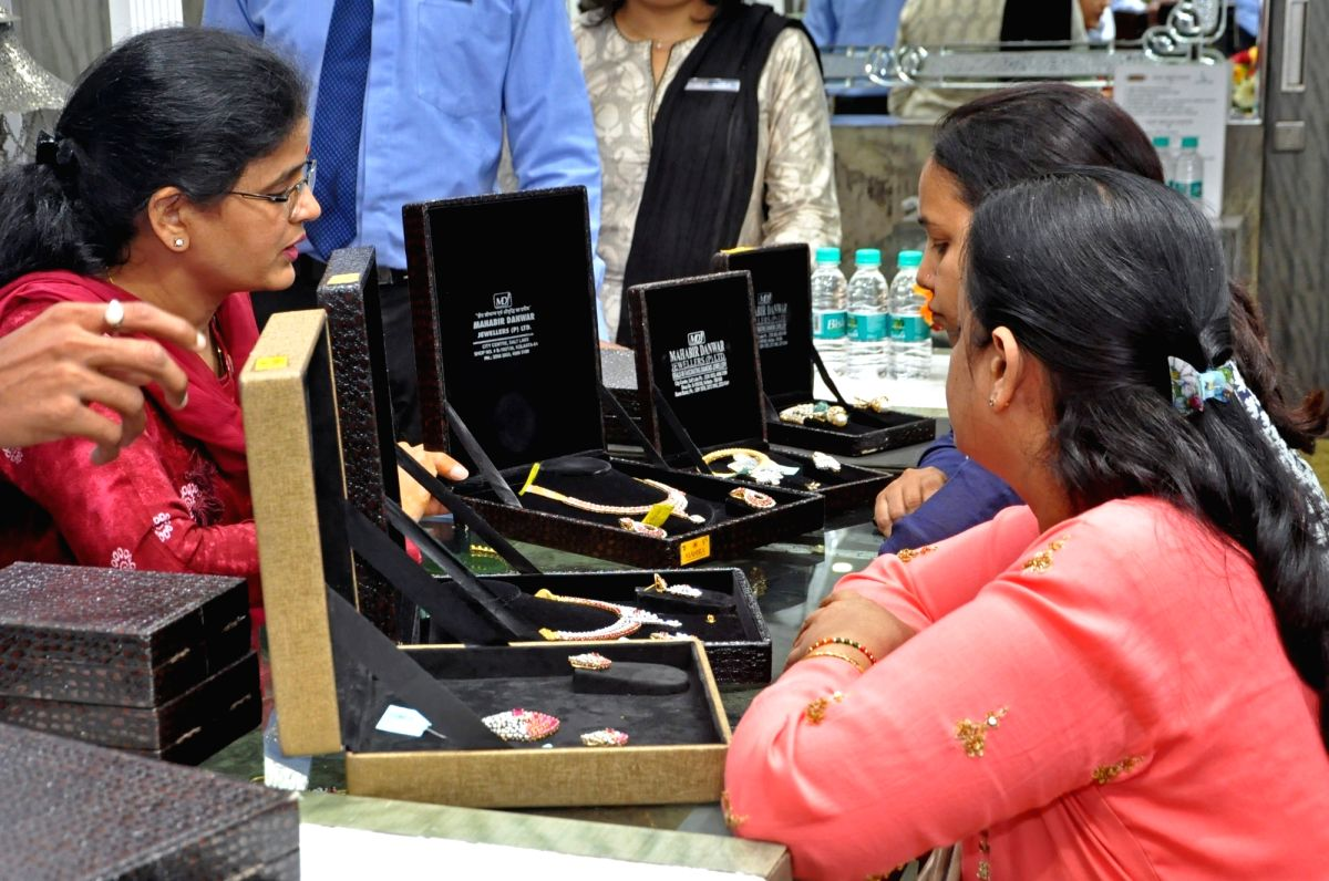 Kolkata: Women shop for jewelry on the occasion of Dhanteras, in Kolkata on Oct 25, 2019. (Photo: Kuntal Chakrabarty/IANS)