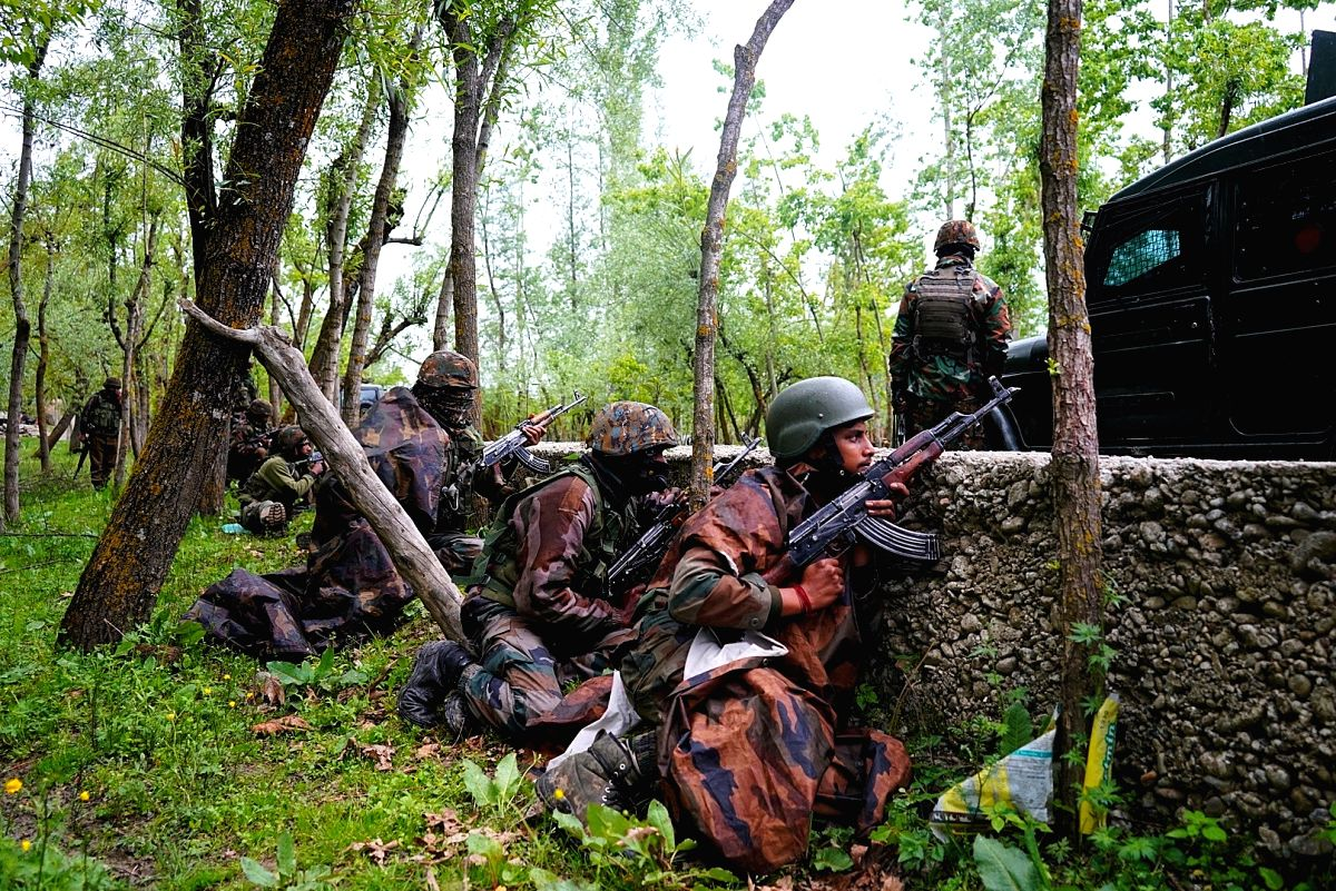 Kupwara: Security personnel take position during a cordon and search operation after an encounter between holed up terrorists and the security forces in the Chanjimulla village of Handwara tehsil in Jammu and Kashmir's Kupwara district on May 3, 2020