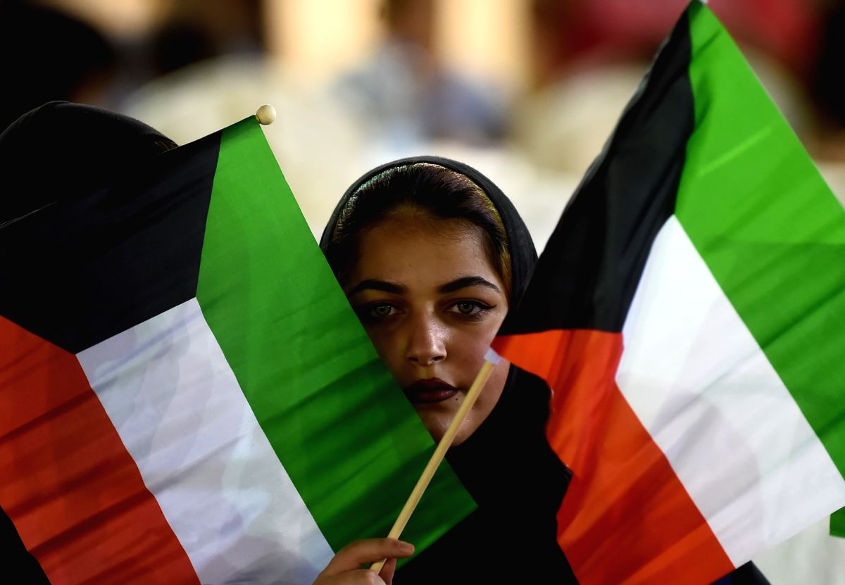 KUWAIT CITY, Aug. 7, 2019 (Xinhua) -- A Kuwaiti woman holds Kuwait flags during an event in Kuwait City, Kuwait, on Aug. 7, 2019. An event was held on Wednesday in Kuwait City to commemorate the 29th anniversary of the 1990 Gulf War. (Photo by Asad/X