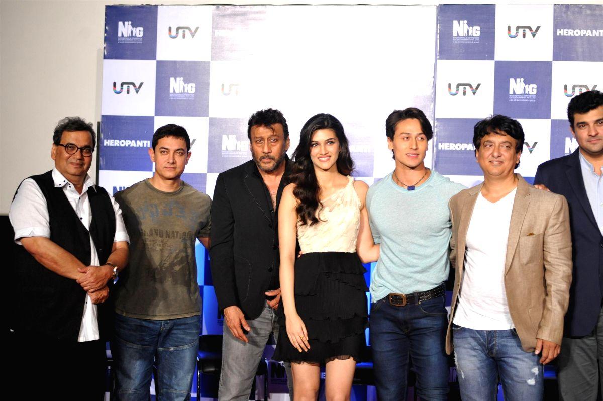 (L to R) Bollywood filmmaker Subhash Ghai, actors Aamir Khan, Kriti Sanon, Tiger Shroff, Jackie Shroff, Sajid Nadiadwala and filmmaker Siddharth Roy Kapur during the trailer launch of film Heropanti in Mumbai, on April 4, 2014.