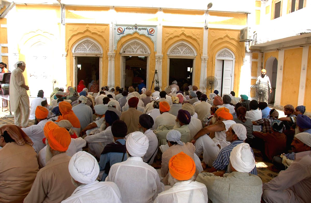 Indian Sikh devotees pray at the Gurdwara Dhara Sahib