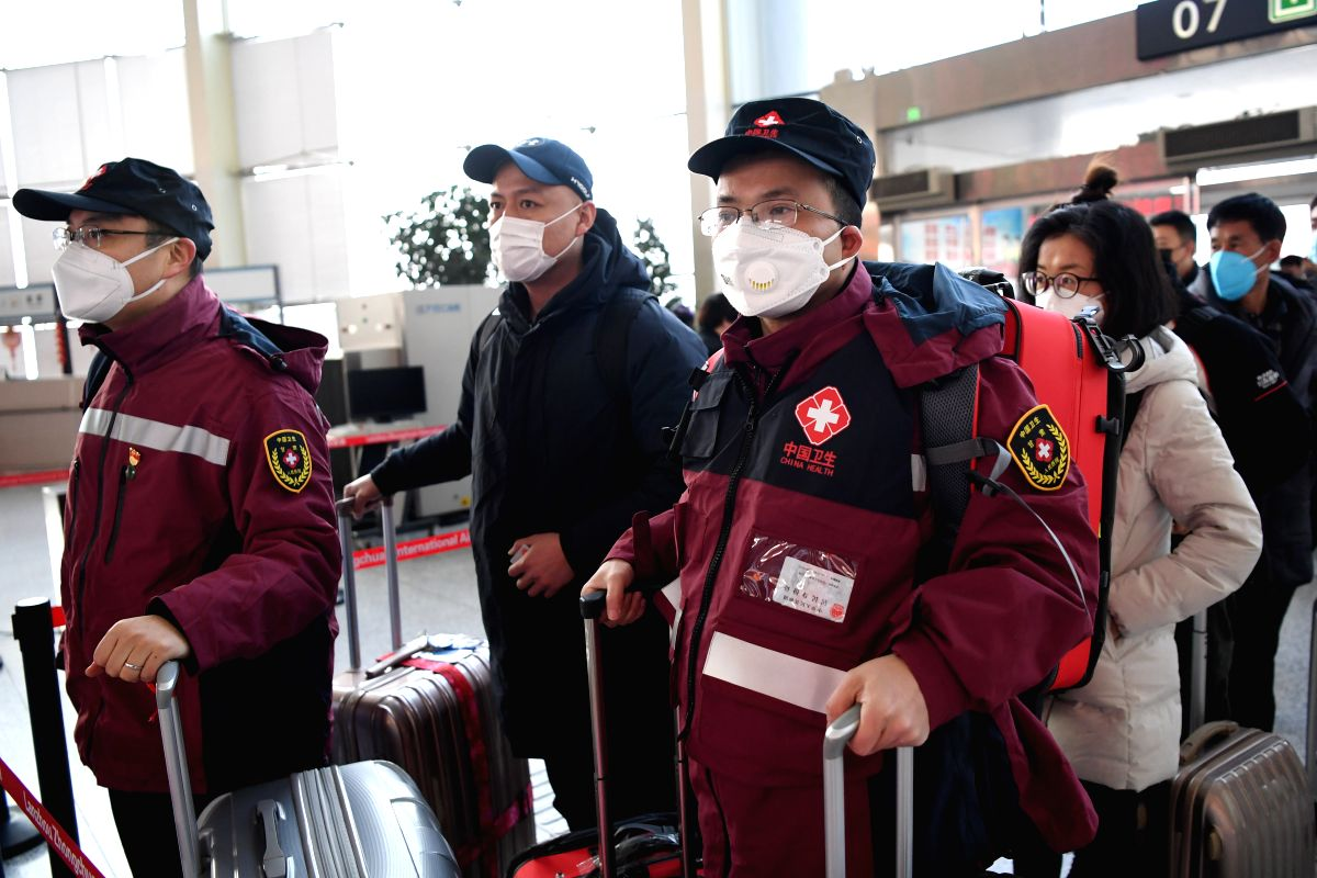 LANZHOU, Jan. 28, 2020 (Xinhua) -- Members of a medical team prepare to leave for Wuhan of Hubei Province at Zhongchuan International Airport in Lanzhou, northwest China's Gansu Province, Jan. 28, 2020. A medical team comprised of 137 medical workers