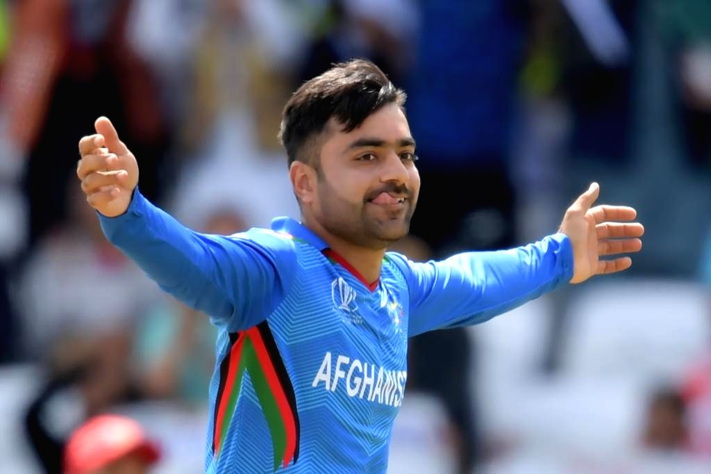 Leeds: Afghanistan's Rashid Khan celebrates fall of a wicket during the 27th match of 2019 World Cup between West Indies and Afghanistan at Headingley Cricket Ground in Leeds, England on July 4, 2019. (Photo Credit: Twitter/@cricketworldcup)