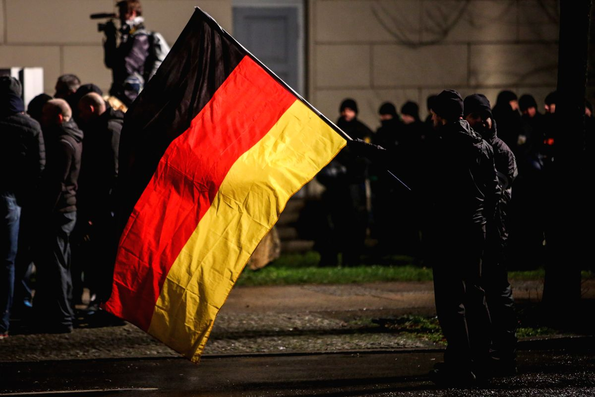 """LEIPZIG, Jan. 12, 2016(Xinhua)-- Followers of """"Leipzig's Europeans against the Islamization of the West"""" (LEGIDA) holding a Germany's national flag attend a demonstration in Leipzig, Germany, on Jan. 11, 2016. (Xinhua/Zhang Fan)(azp)"""