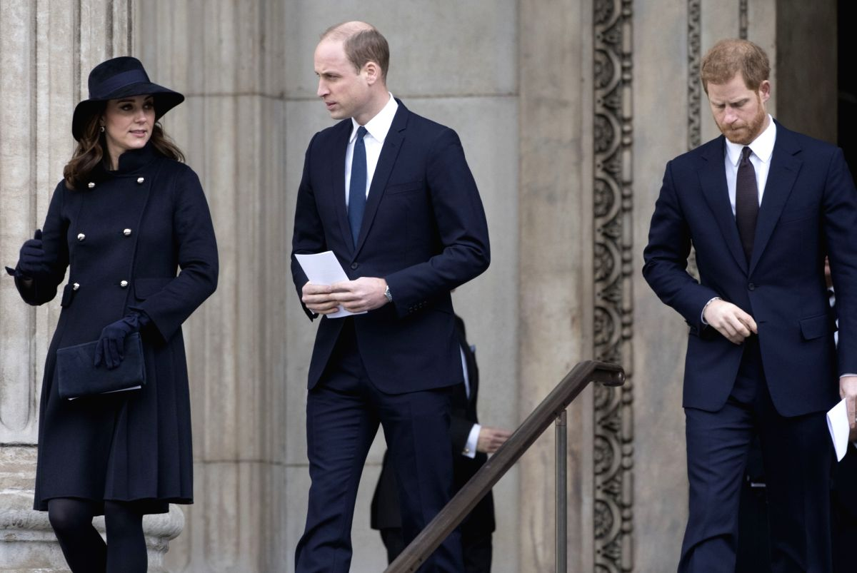 LONDON, Dec. 14, 2017 (Xinhua) -- Prince William (C), his wife Catherine, and Prince Harry leave the Grenfell tower National Memorial Service at St. Paul's Cathedral in London, Britain, on Dec. 14, 2017. A grand memorial service was held Thursday her