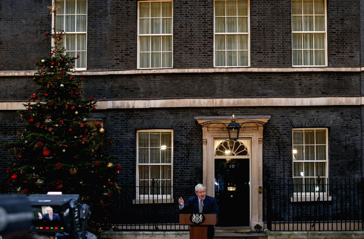 LONDON, Dec. 14, 2019 (Xinhua) -- British Prime Minister Boris Johnson speaks outside 10 Downing Street in London, Britain, Dec. 13, 2019. Boris Johnson headed to Buckingham Palace Friday for an audience with Queen Elizabeth following his win in Thur