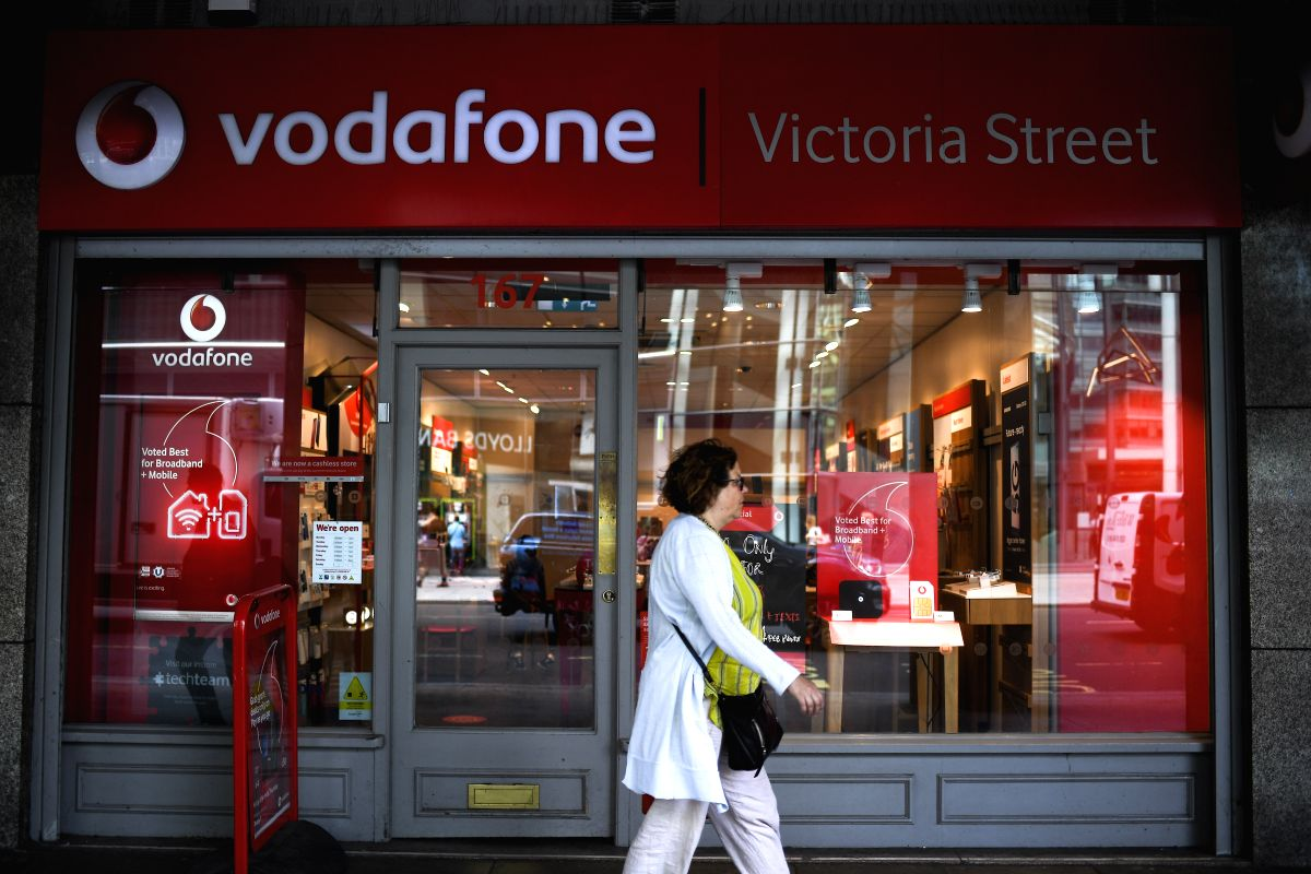 LONDON, July 3, 2019 (Xinhua) -- A woman walks past a Vodafone store in London, Britain, July 3, 2019. Vodafone UK on Wednesday switched on its 5G service, becoming the second UK mobile operator to turn on its 5G network relying on Huawei equipment.