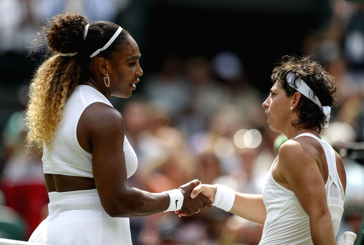 LONDON, July 8, 2019 (Xinhua) -- Serena Williams (L) of the United States greets Carla Suarez Navarro of Spain after the women's singles fourth round match at the 2019 Wimbledon Tennis Championships in London, Britain, on July 8, 2019. (Xinhua/Han Ya