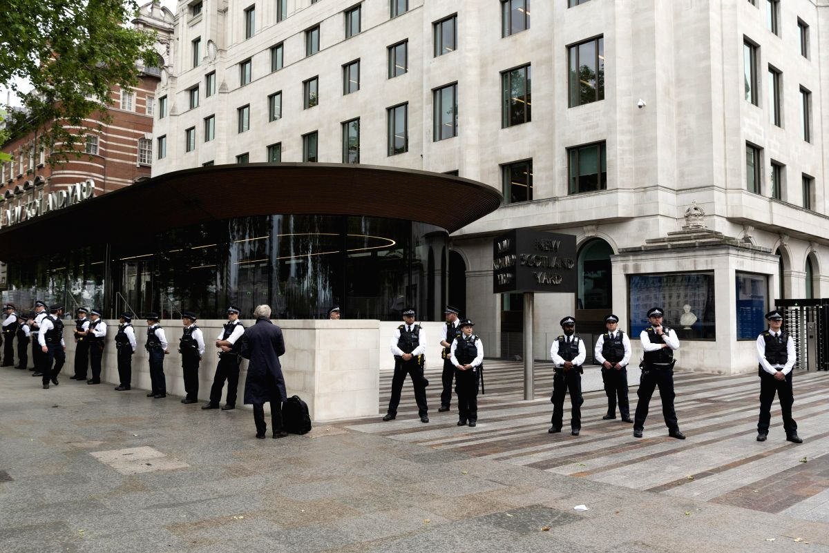 LONDON, June 3, 2020 (Xinhua) -- Police officers stand guard outside New Scotland Yard as protesters take part in a demonstration in London, Britain, on June 3, 2020. Thousands of people gathered in London on Wednesday to protest over the death of Ge
