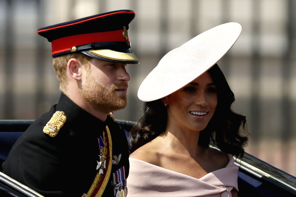LONDON, June 9, 2018 (Xinhua) -- Britain's Prince Harry and Meghan, Duchess of Sussex, depart from Buckingham Palace during the Trooping the Colour ceremony to mark Queen Elizabeth II's 92nd birthday in London, Britain on June 9, 2018. (Xinhua/Tim Ir