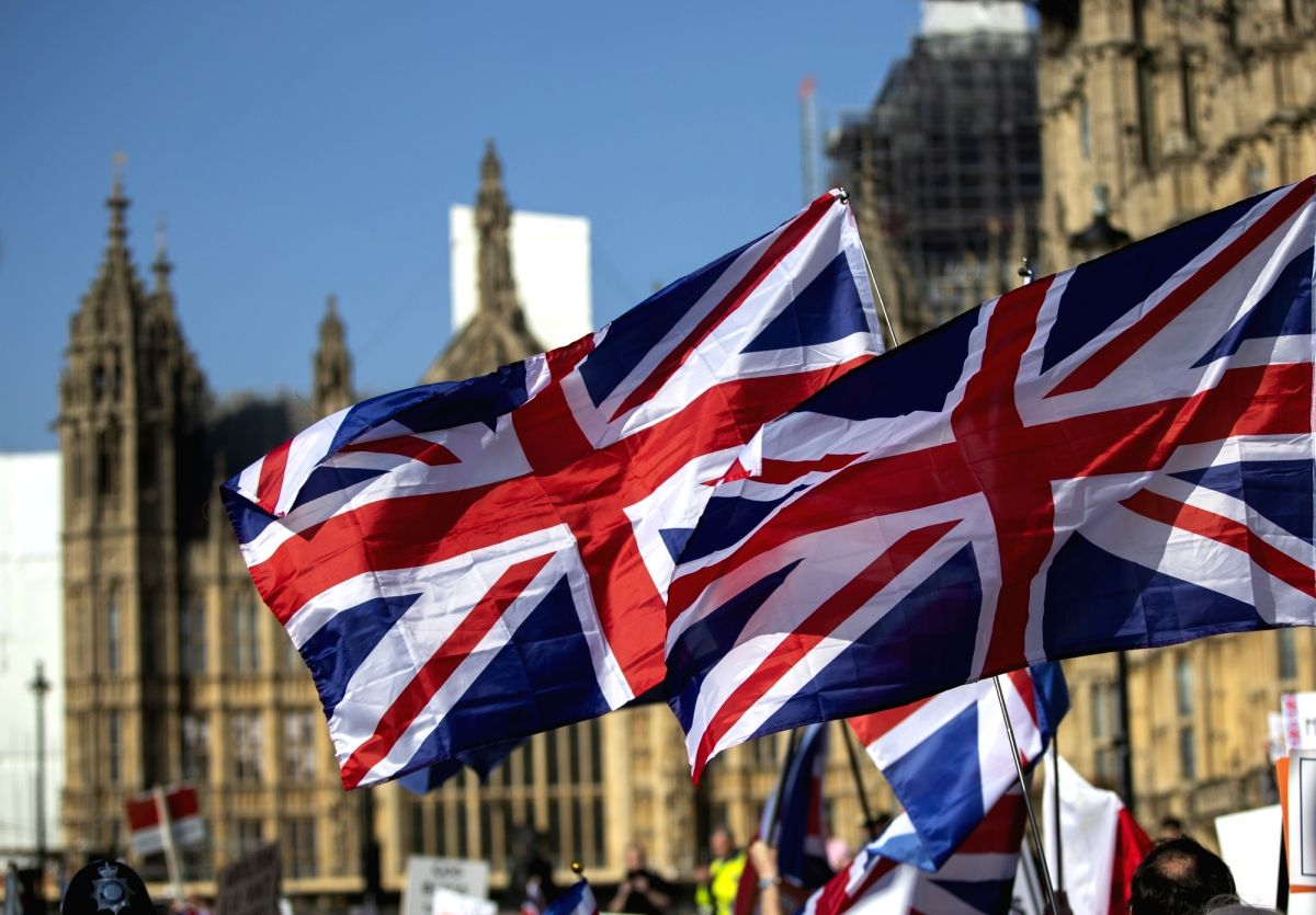 LONDON, March 29, 2019 (Xinhua) -- The U.K. flags are seen during a protest outside the Houses of Parliament in London, Britain, on March 29, 2019. British lawmakers on Friday voted to reject Prime Minister Theresa May's Brexit deal, which has alread