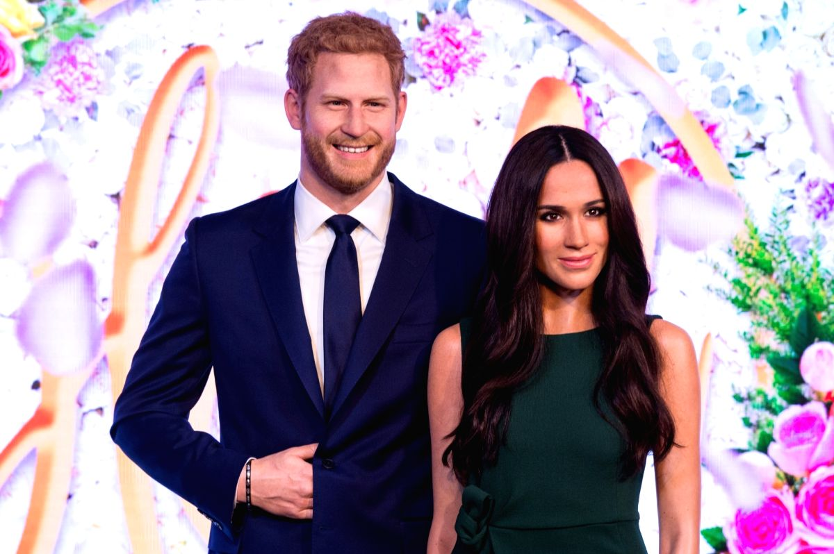 LONDON, May 9, 2018 (Xinhua) -- Photo taken on May 9, 2018 shows wax figures of Meghan Markle and Prince Harry at Madame Tussauds in London, Britain. A new wax figure of Meghan Markle was unveiled ahead of her wedding to Prince Harry on May 19 at Mad