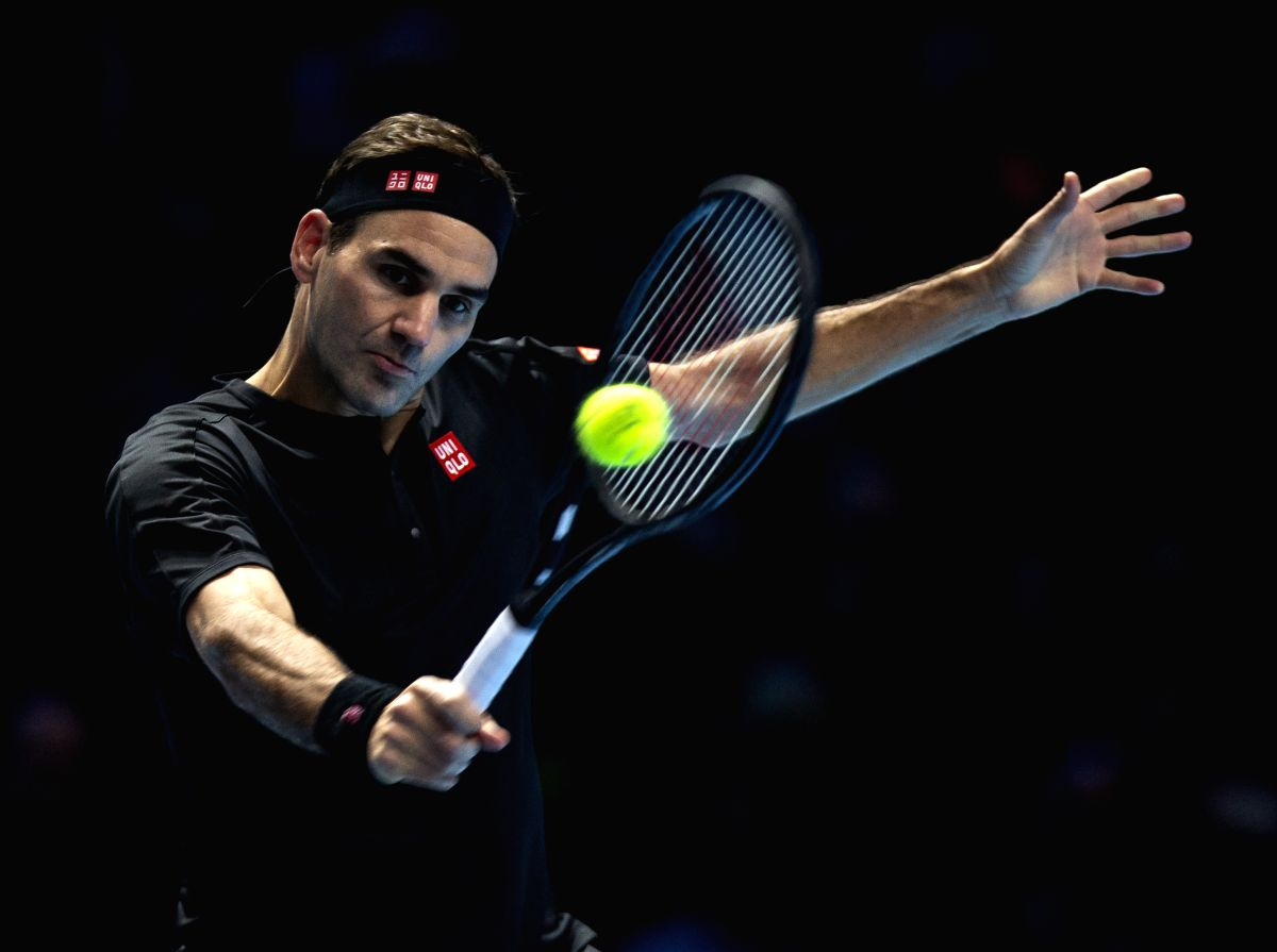 LONDON, Nov. 11, 2019 (Xinhua) -- Roger Federer of Switzerland returns a shot during the singles group match against Dominic Thiem of Austria at the ATP World Tour Finals 2019 in London, Britain on Nov. 10, 2019. (Xinhua/Han Yan/IANS)