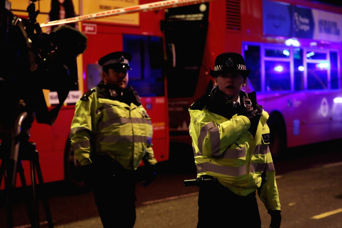 LONDON, Nov. 29, 2019 (Xinhua) -- Police officers cordon off the scene in the south side of London Bridge following an attack in London, Britain, on Nov. 29, 2019. Police confirmed on Friday that two people who were injured in a London Bridge terror