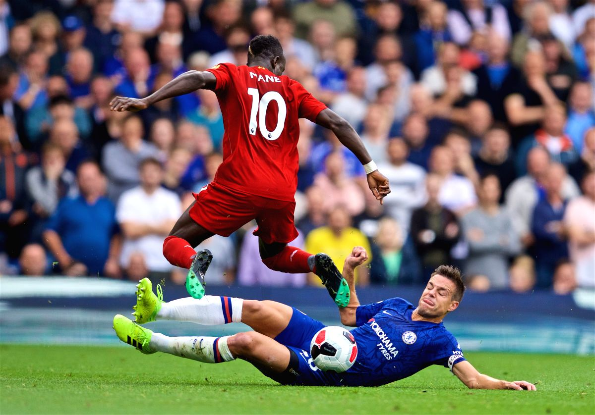 LONDON, Sept. 23, 2019 (Xinhua) -- Liverpool's Sadio Mane (L) is tackled by Chelsea's Cesar Azpilicueta during the English Premier League match between Chelsea and Liverpool at Stamford Bridge in London, Britain on Sept. 22, 2019. (Xinhua/IANS)
