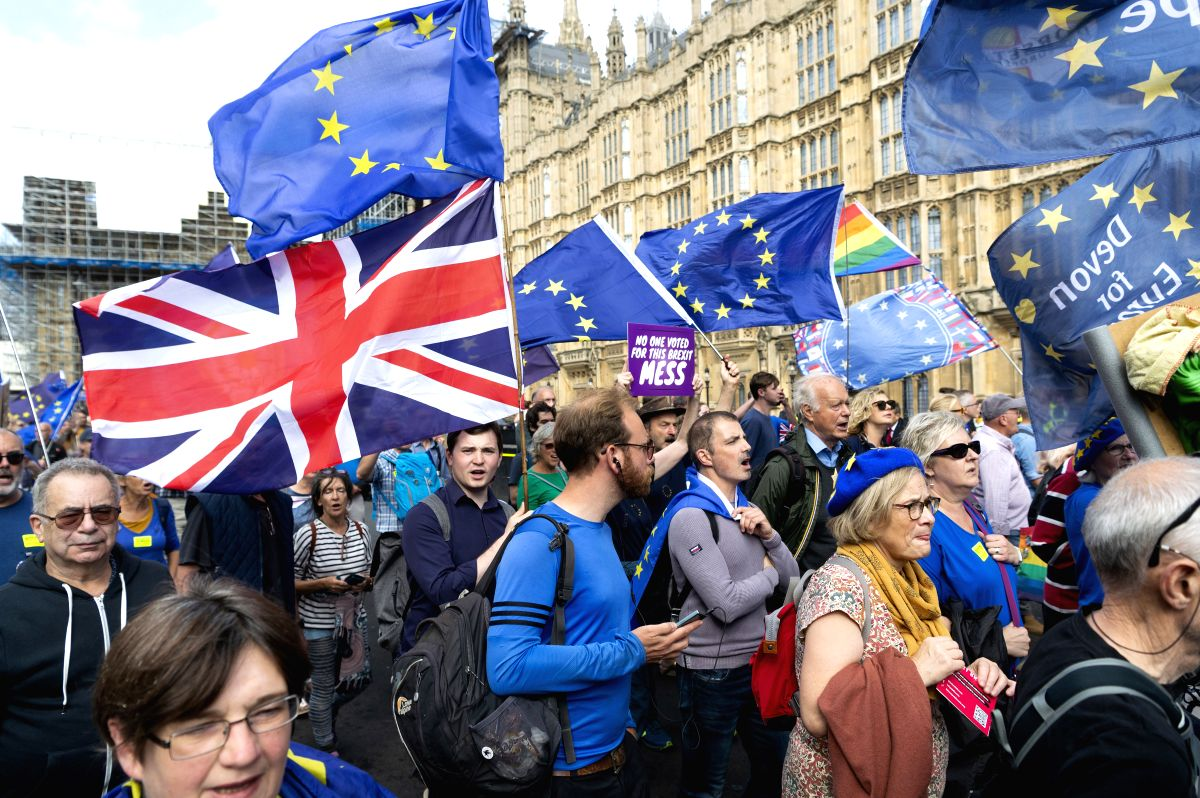 LONDON, Sept. 3, 2019 (Xinhua) -- Anti-Brexit protesters take part in a demonstration in London, Britain, on Sept. 3, 2019. British Prime Minister Boris Johnson on Tuesday lost a key Brexit vote in the House of Commons as anti-no deal MPs take contro