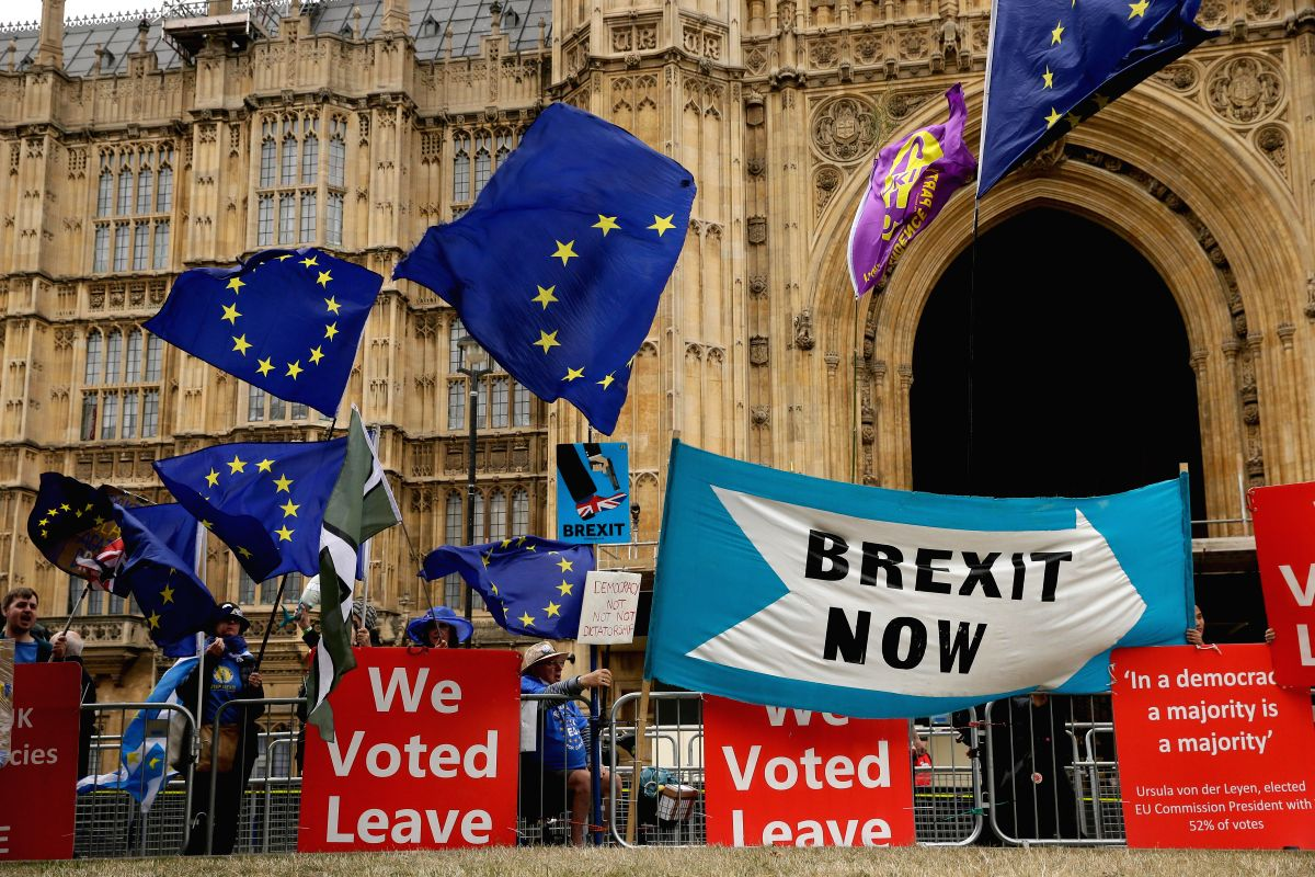 LONDON, Sept. 3, 2019 (Xinhua) -- Demonstrators gather outside the Houses of Parliament in London, Britain, Sept. 3, 2019. Rebel Tory members of the British parliament are poised to join their colleagues from opposition Labour to bring forward a bill
