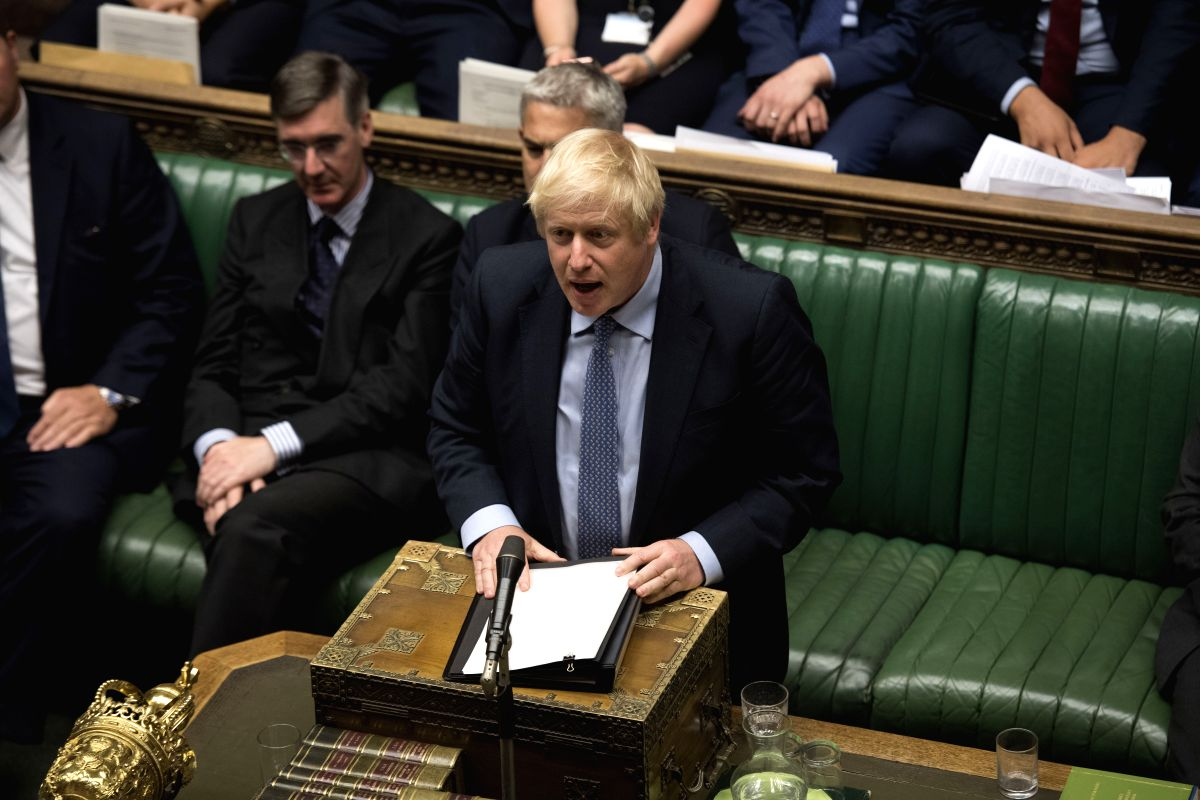 LONDON, Sept. 4, 2019 (Xinhua) -- British Prime Minister Boris Johnson (C) speaks in the House of Commons in London, Britain, on Sept. 4, 2019. British lawmakers on Wednesday rejected a motion tabled by Prime Minister Boris Johnson calling for a gene