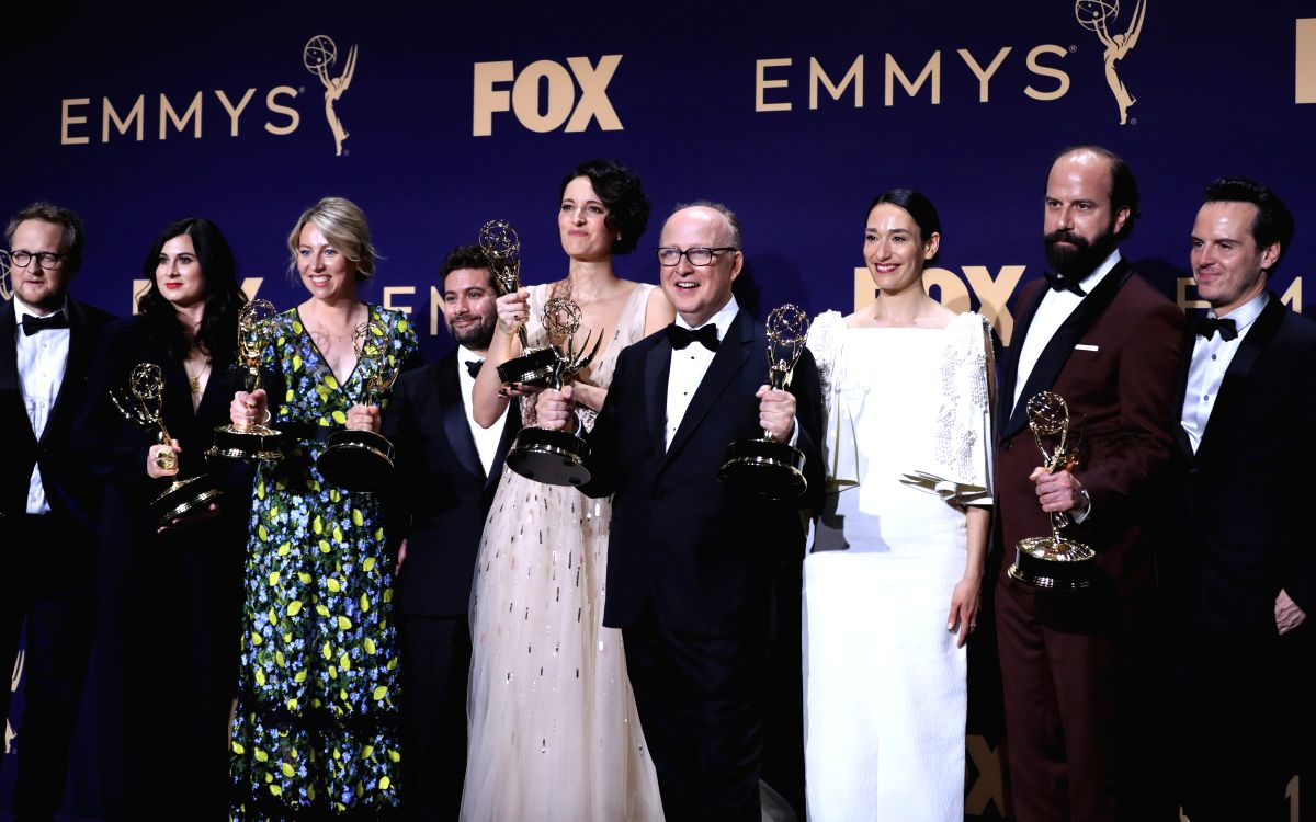 """LOS ANGELES, Sept. 23, 2019 (Xinhua) -- Cast members of """"Fleabag"""" pose with the award for outstanding comedy series during the 71st Primetime Emmy Awards in Los Angeles, the United States, Sept. 22, 2019. (Xinhua/Li Ying/IANS)"""