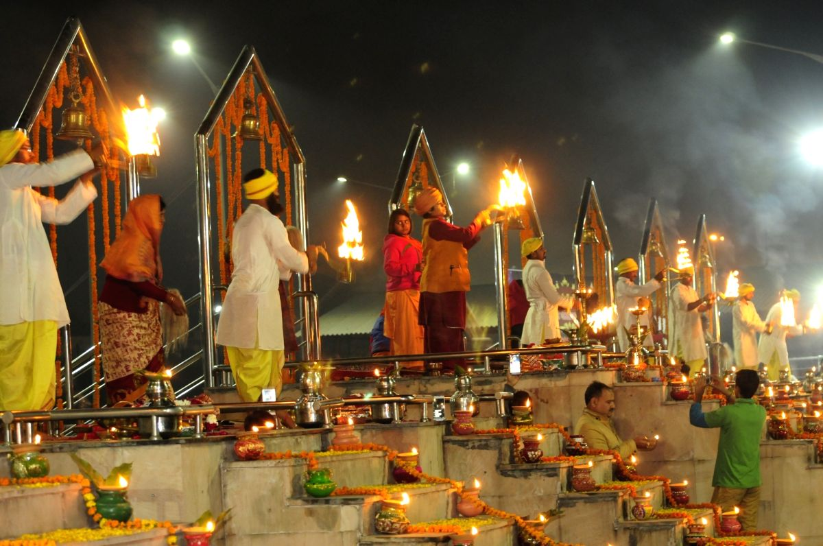 'Aarti' -a ceremony in which lights with wicks soaked in ghee are lit and offered to one or more deities - underway on the banks of Gomti river