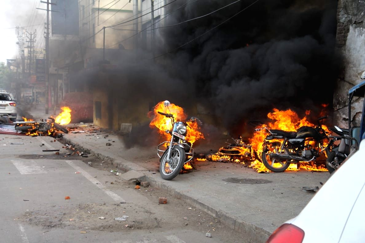 Lucknow: Angry protesters went on rampage and set ablaze vehicles during their protest against the Citizenship Amendment Act (CAA) 2019, in Lucknow on Dec 19, 2019. Violence erupted during protests against CAA on Thursday afternoon in various cities