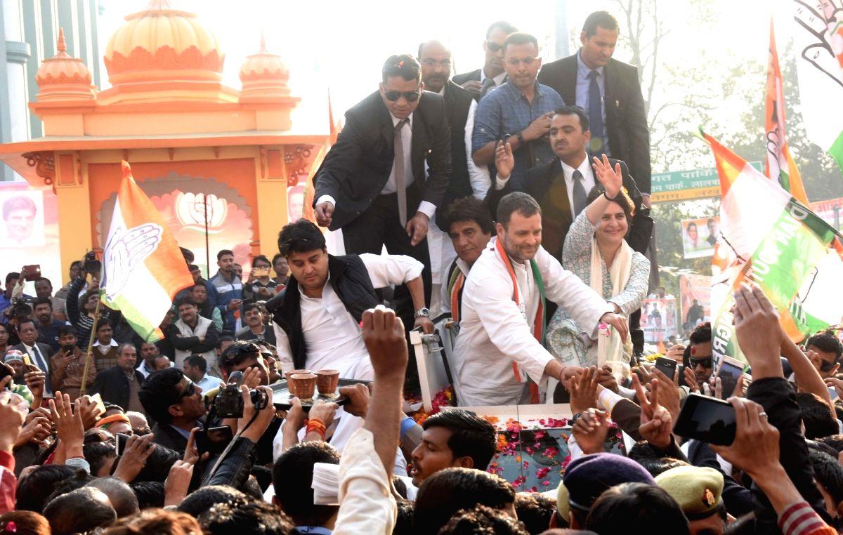 Congress leaders Rahul Gandhi, Priyanka Gandhi Vadra and Jyotiraditya Scindia during a road show