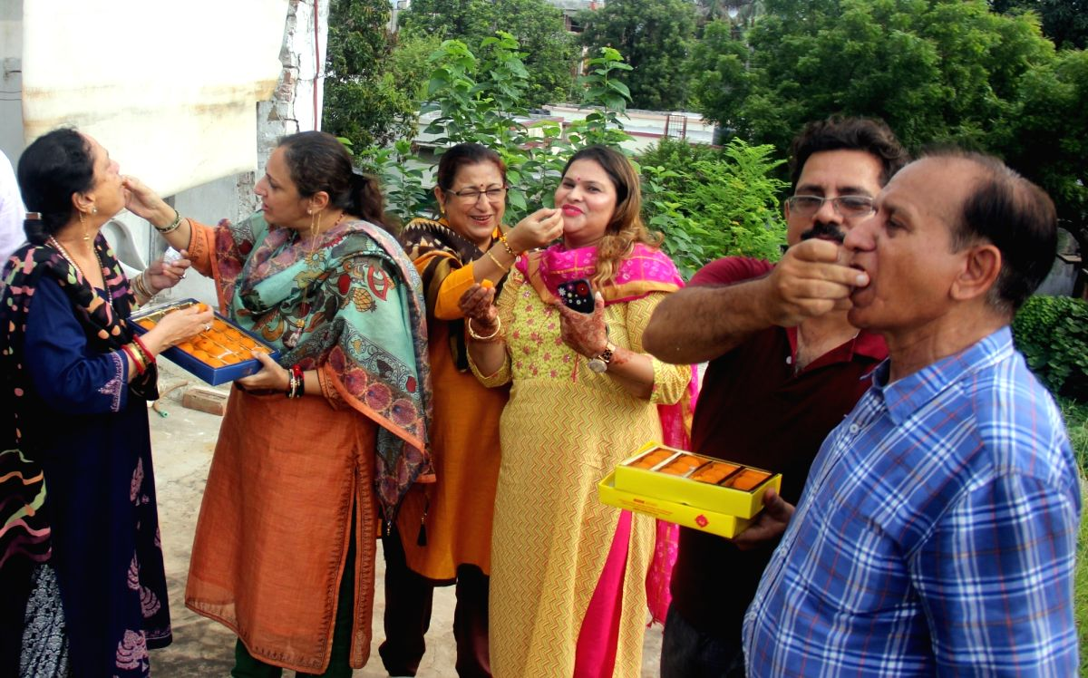 Lucknow: Kashmiri Pandits celebrate the Centre's decision to scrap Article 370 of the Constitution and to give Jammu and Kashmir a Union Territory status; in Lucknow on Aug 5, 2019.
