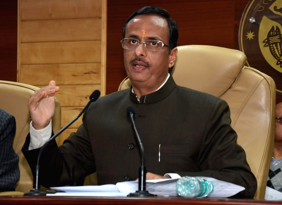 Lucknow: Uttar Pradesh Deputy Chief Minister Dinesh Sharma addresses a press conference in Lucknow on Jan 8, 2017.