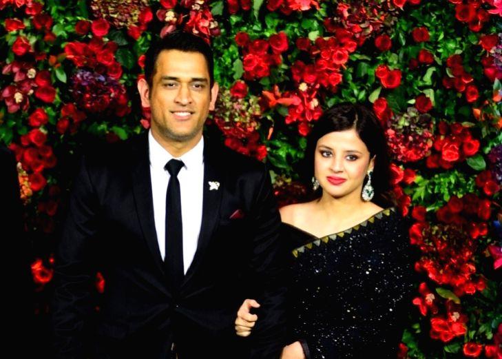 Mahendra Singh Dhoni and Sakshi Dhoni. (Image Source: IANS)
