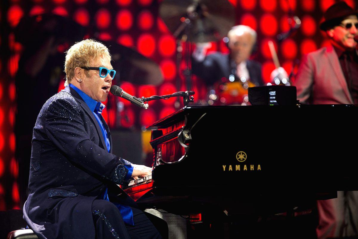 "Malaga: British singer and songwriter Elton John performs during a concer at Palacio de Deportes José María Martín Carpena, upon his tour ""Elton John and his band"" in Malaga, Spain, on 15 July 2015. (IANS/EFE/Jorge Zapata)"