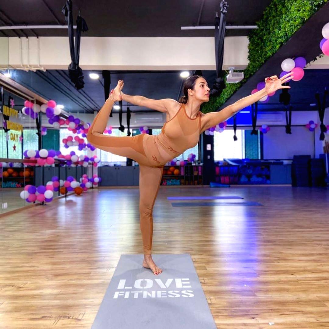 Malaika Arora performs yoga.