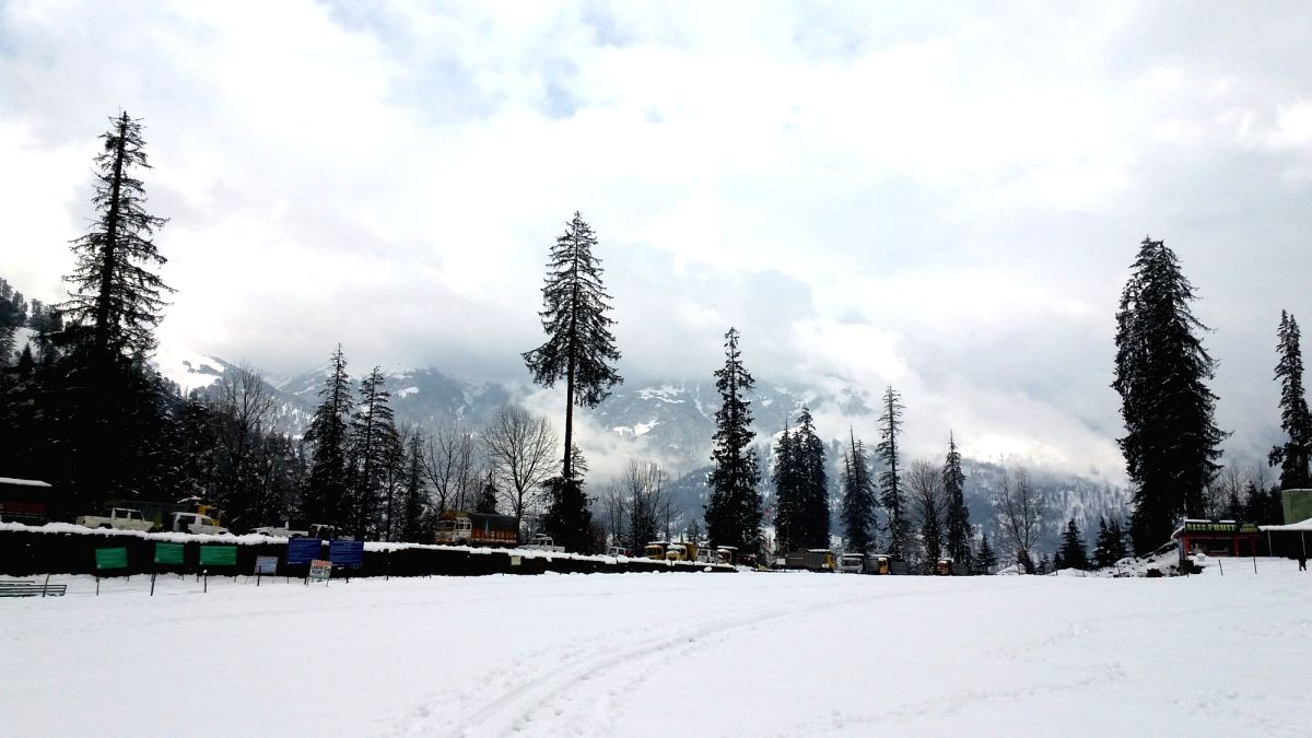 Manali: A view of snow clad Manali after fresh snowfalls on Dec 13, 2017.