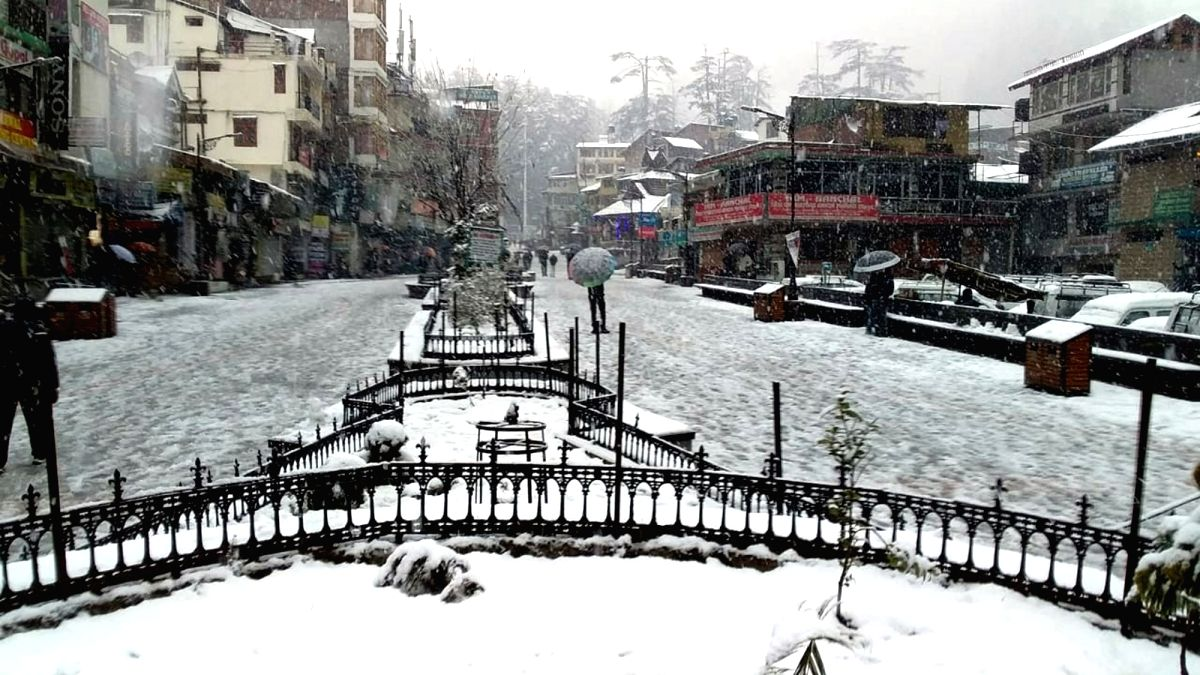 Manali: A view of the snow-covered Mall Road during snowfall in Manali, on Jan 22, 2019.