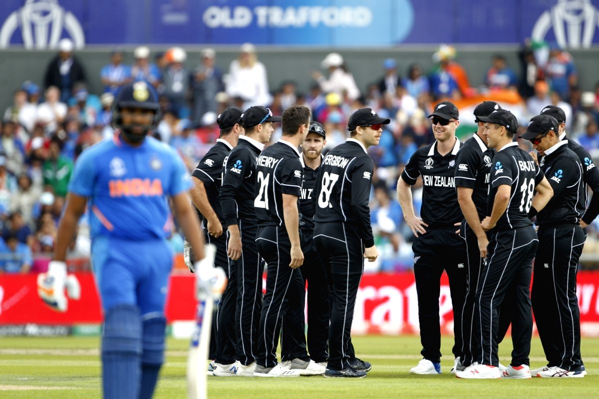 Manchester: New Zealand's Matt Henry celebrates fall of Rohit Sharma's wicket during the 1st Semi-final match of 2019 World Cup between India and New Zealand at Old Trafford in Manchester, England on July 10, 2019. (Photo: Surjeet Kumar/IANS)