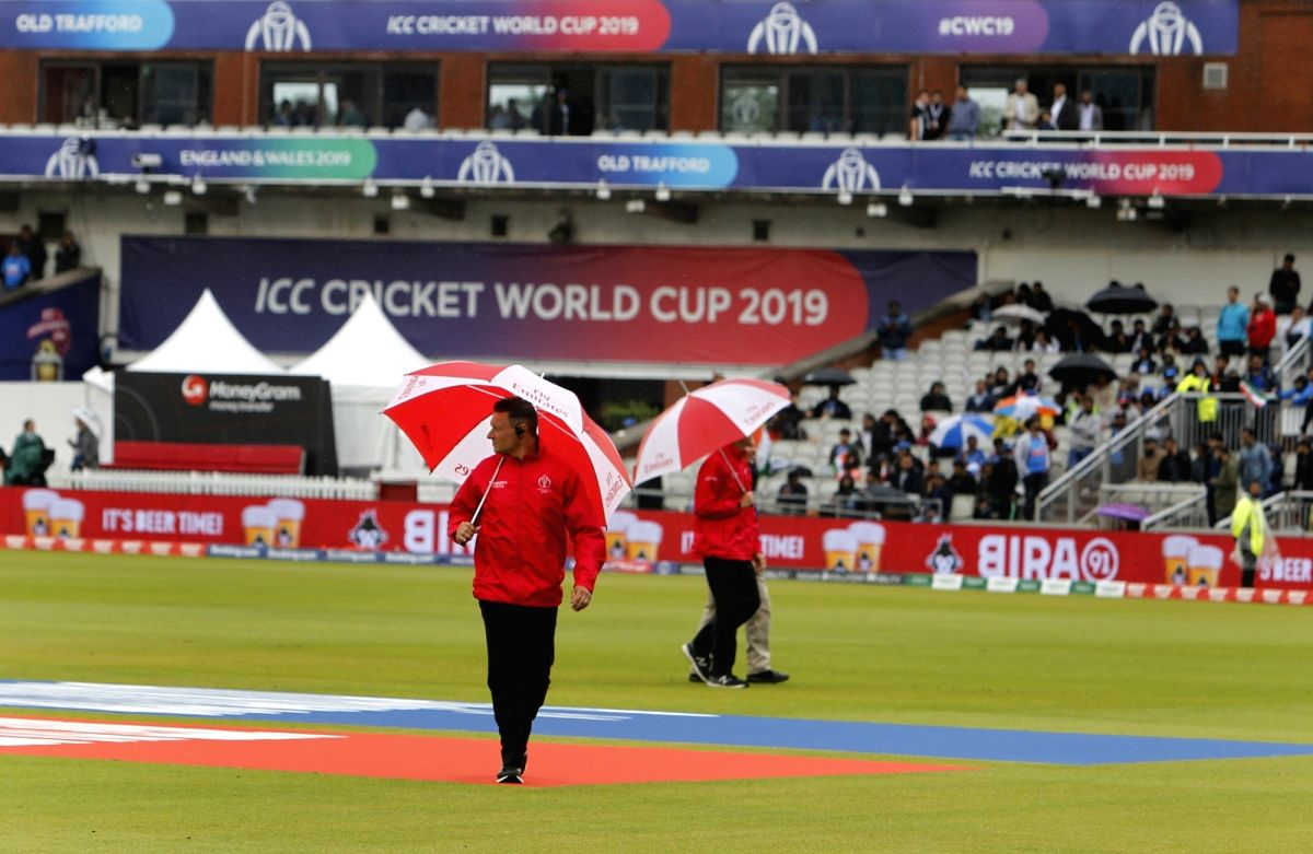 Manchester: Umpires inspect the ground after rains interrupt the 1st Semi-final match of 2019 World Cup between India and New Zealand at Old Trafford in Manchester, England on July 9, 2019. New Zealand will resume their innings on Wednesday on the sa