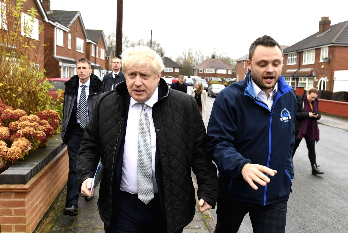 MANSFIELD, Nov. 17, 2019 (Xinhua) -- Britain's Prime Minister Boris Johnson (Front L) accompanies Conservative party candidate for the Mansfield constituency Ben Bradley (R) canvassing during a General Election campaign in Mansfield, Britain on Nov.