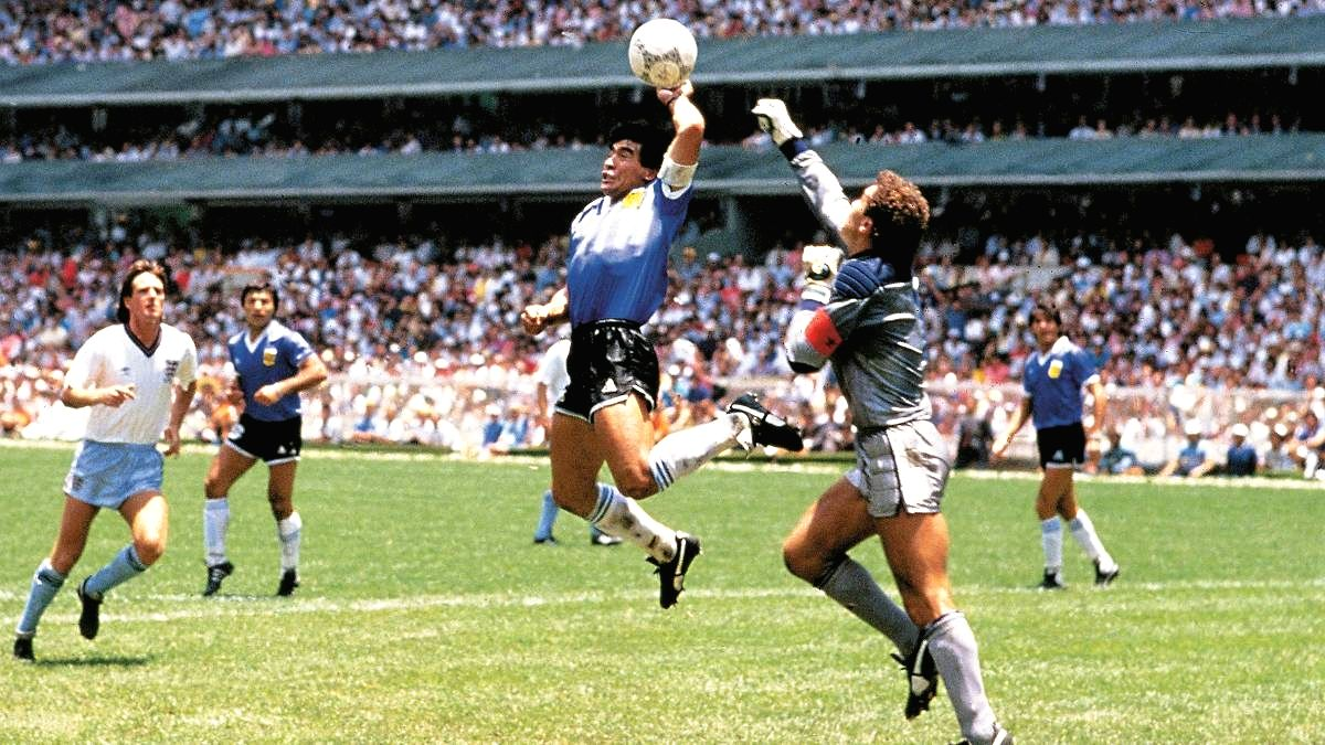 Maradona goes off to shake the Hand of God.